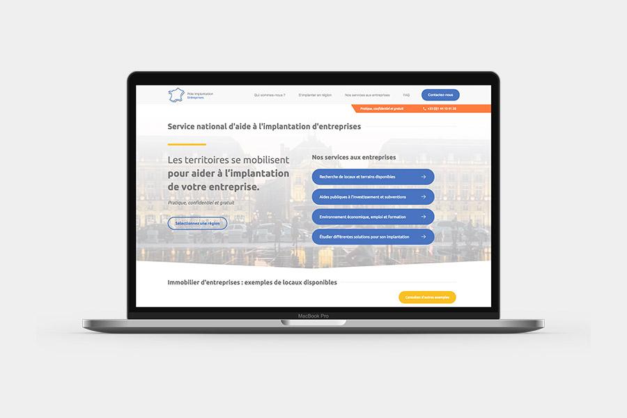 Site Pôle Implantation Entreprises affiché sur ordinateur portable